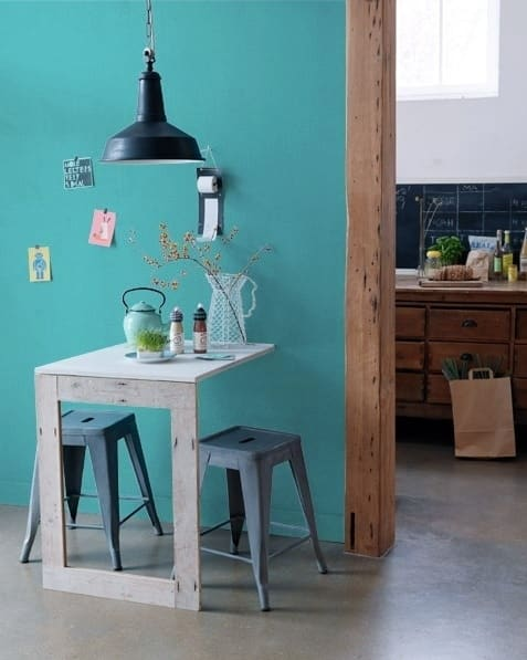 Build a super simple foldout table that's mounted to the wall.