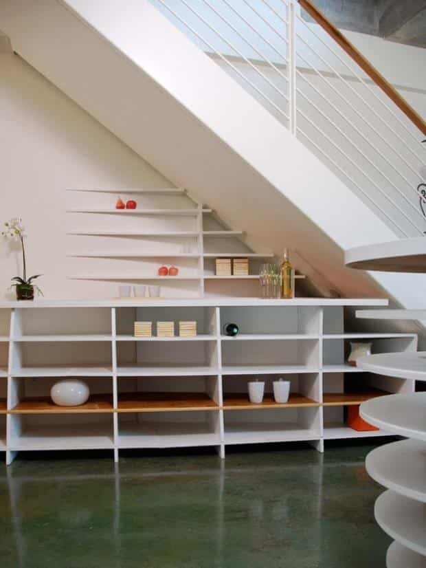 No time for built-ins? Stack shelves or a credenza under your stairs for a sleek look.