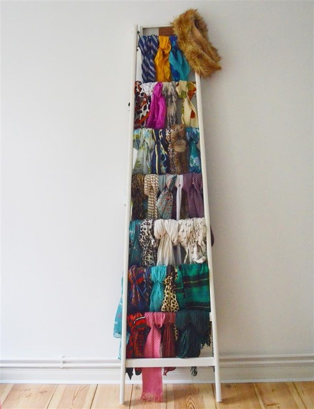 Stop stepping on your ladder and use it as a scarf storage device instead.