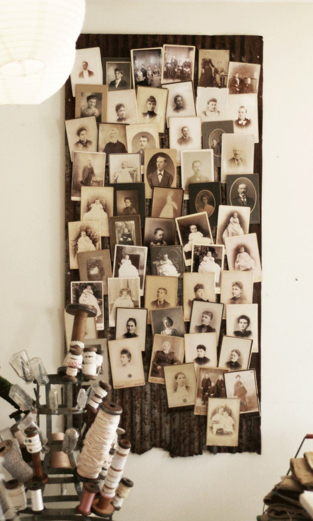 These vintage photos are (fittingly) arranged atop a piece of vintage barn roofing.