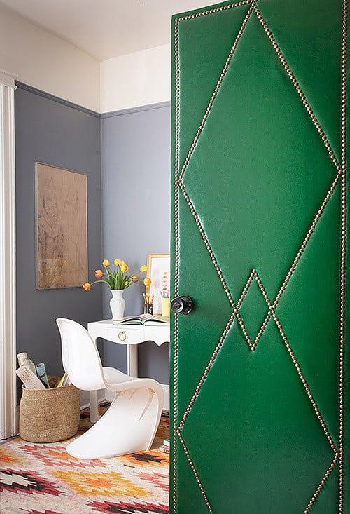 Upholster your door.