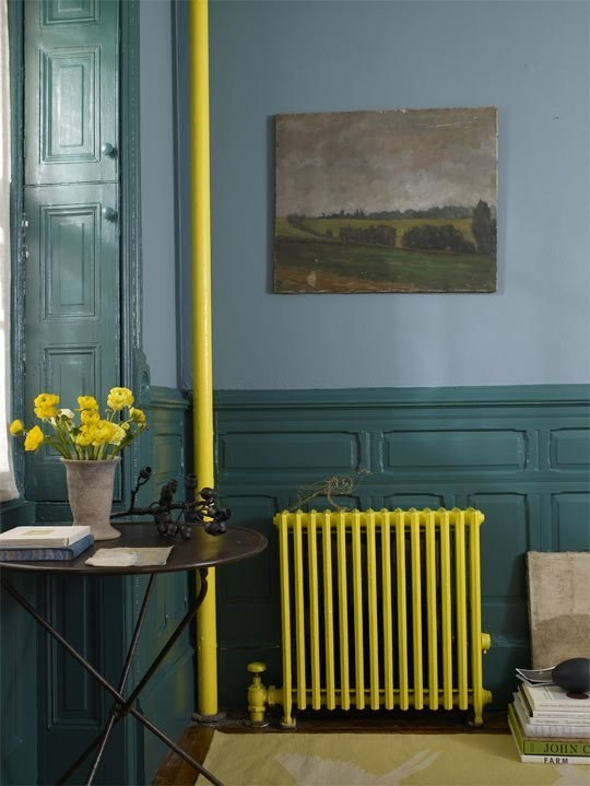 Paint your radiator and pipes a SUPER bright accent color.