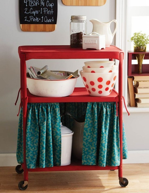 Make a curtain for the bottom tier to hide unsightly kitchen necessities.