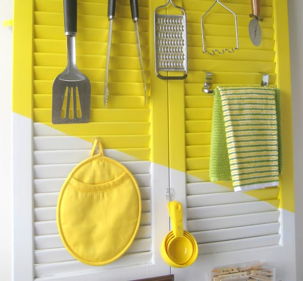 Arrange utensils and cloths on an old shutter door.