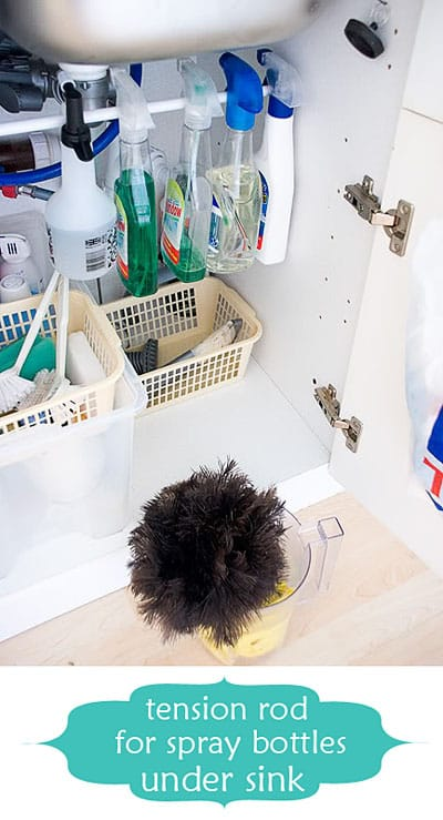 Hang cleaning supplies on a tension rod under your sink.