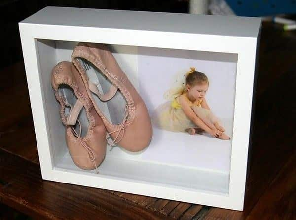 You can also frame your kid's shoes with a photo of him or her wearing them.