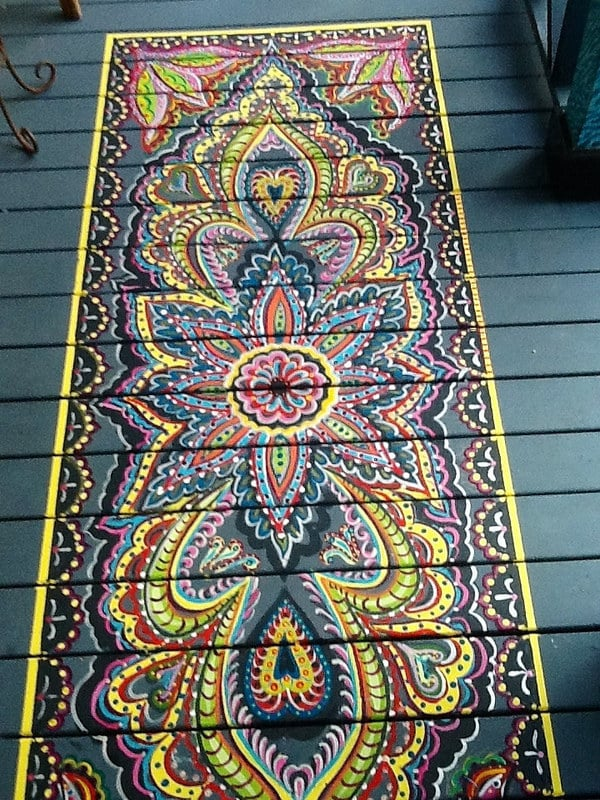 Paint a faux rug on your porch with bright fun colors.