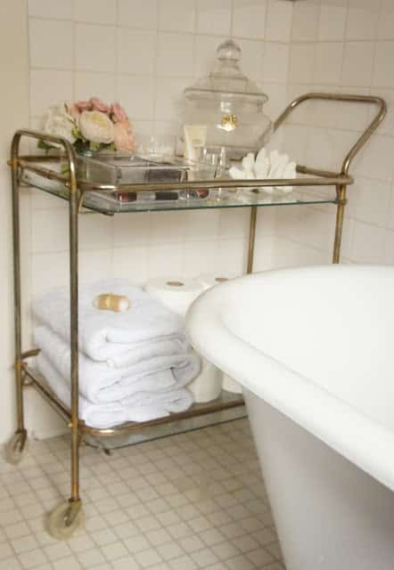 Use a pretty one in the bathroom to store extra towels.