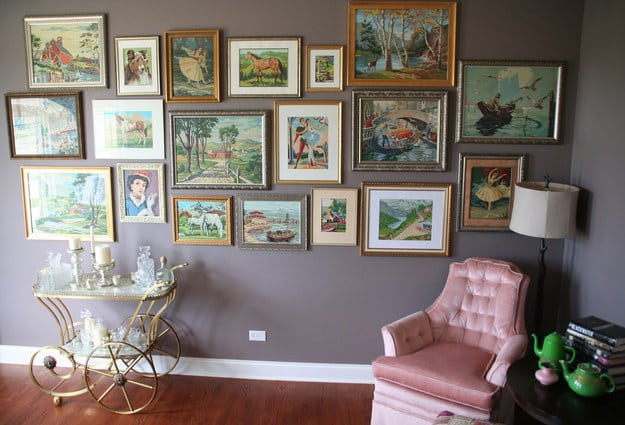 Portraits, paint by number paintings... whatever art you collect, clump it all together on one themed wall.