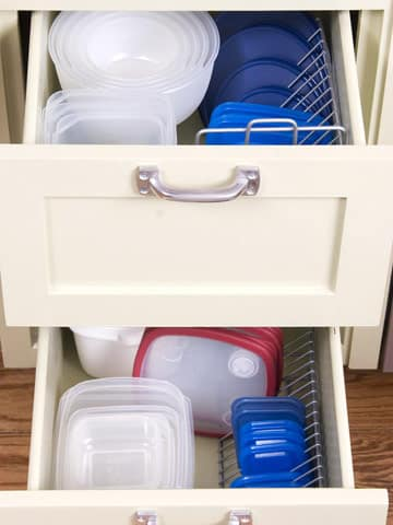 Use CD holders to neatly house Tupperware lids.