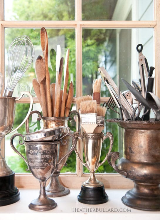 Store utensils in vintage trophies.