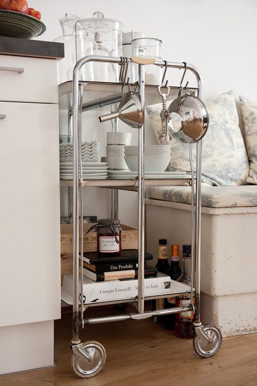 Use it in the kitchen or dining room for storing dishes.