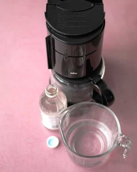 Run 1 part vinegar + 1 part water through a brew cycle in your coffeemaker.
