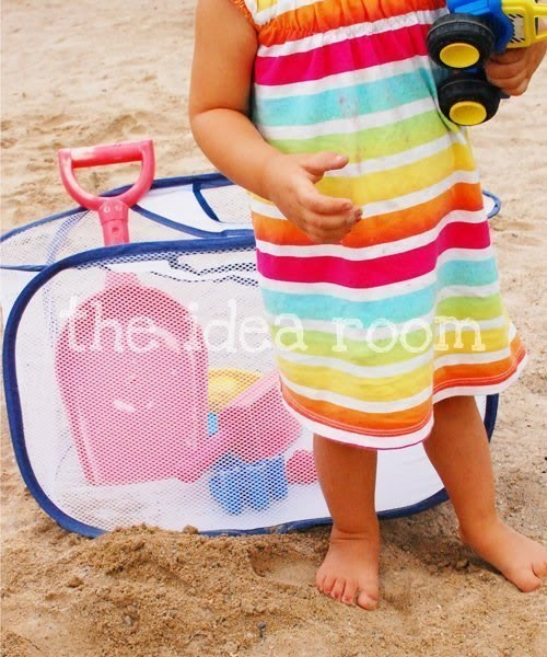 Use a mesh laundry bag to hold toys kids like to play with at the beach.