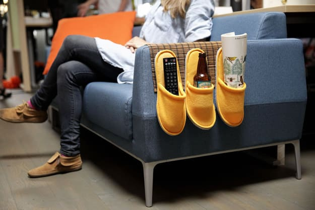 This is somewhat strange, but incredibly useful: a couch caddy made from a Toga place mat and some Njuta slippers.