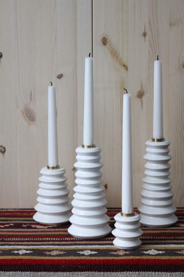 Here's a Kryddig spice mill that has been reformed into a set of modern candlestick holders.