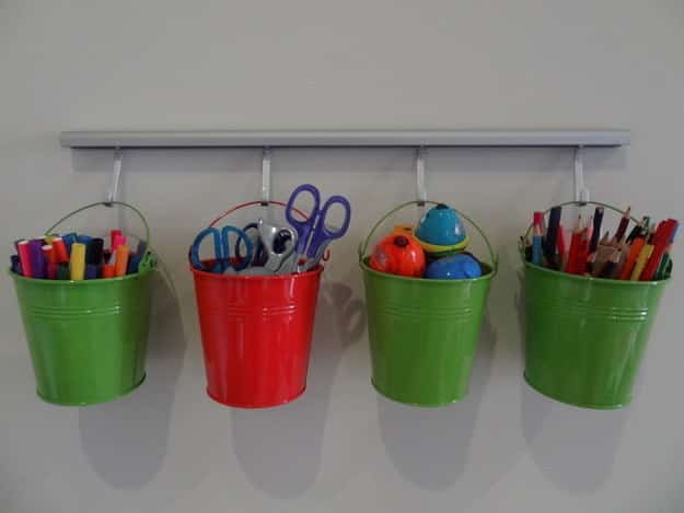 Use buckets to organize their art supplies.