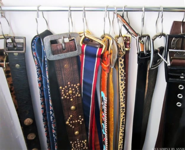 Use shower curtain rings to hang belts.