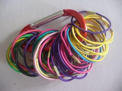 Stash hair ties with a carabiner.
