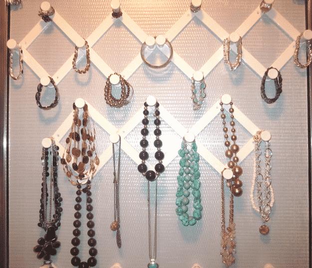 Organize jewelry on accordion hooks.