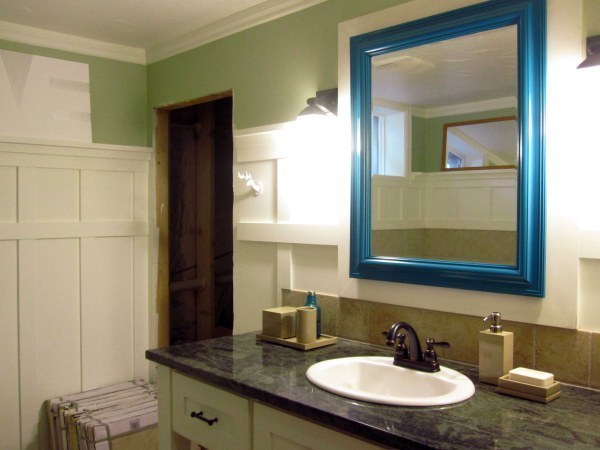 Give a standard bathroom mirror a makeover with a brightly colored frame.