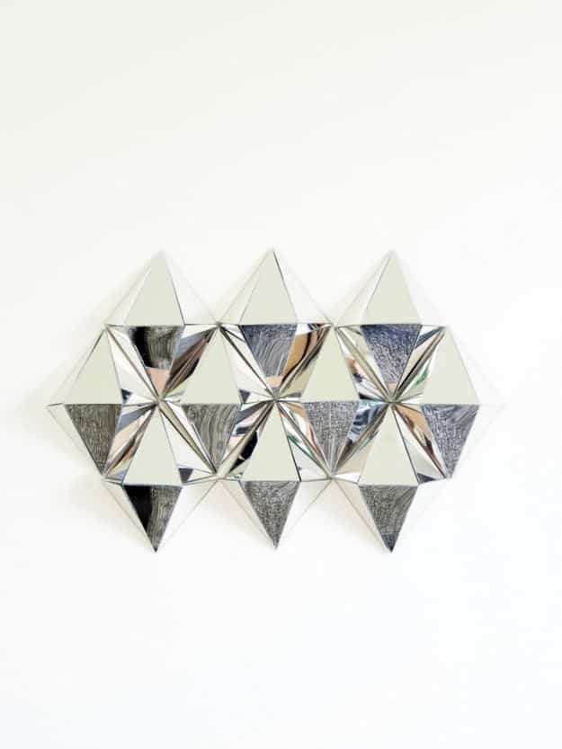 Craft geometric mirrored accents to decorate small bathroom wall areas.