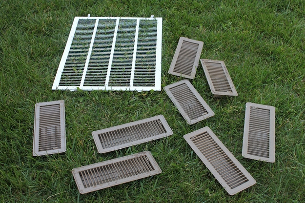 23. Take your vent covers outside and hose them down.