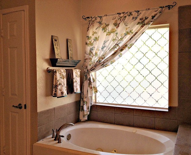 Make your bathroom ~extra private~ by frosting windows using contact paper.