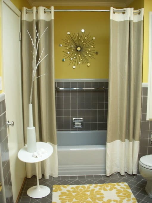 And use two shower curtains for a grander tub.