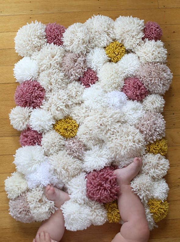 Make cold tile floors 110% cozier with a pom pom rug DIY.