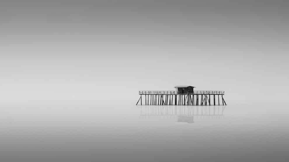 """A house built for fishermen stands alone in the middle of the sea"" in Port Dickson, Negeri Sembilan, Malaysia"