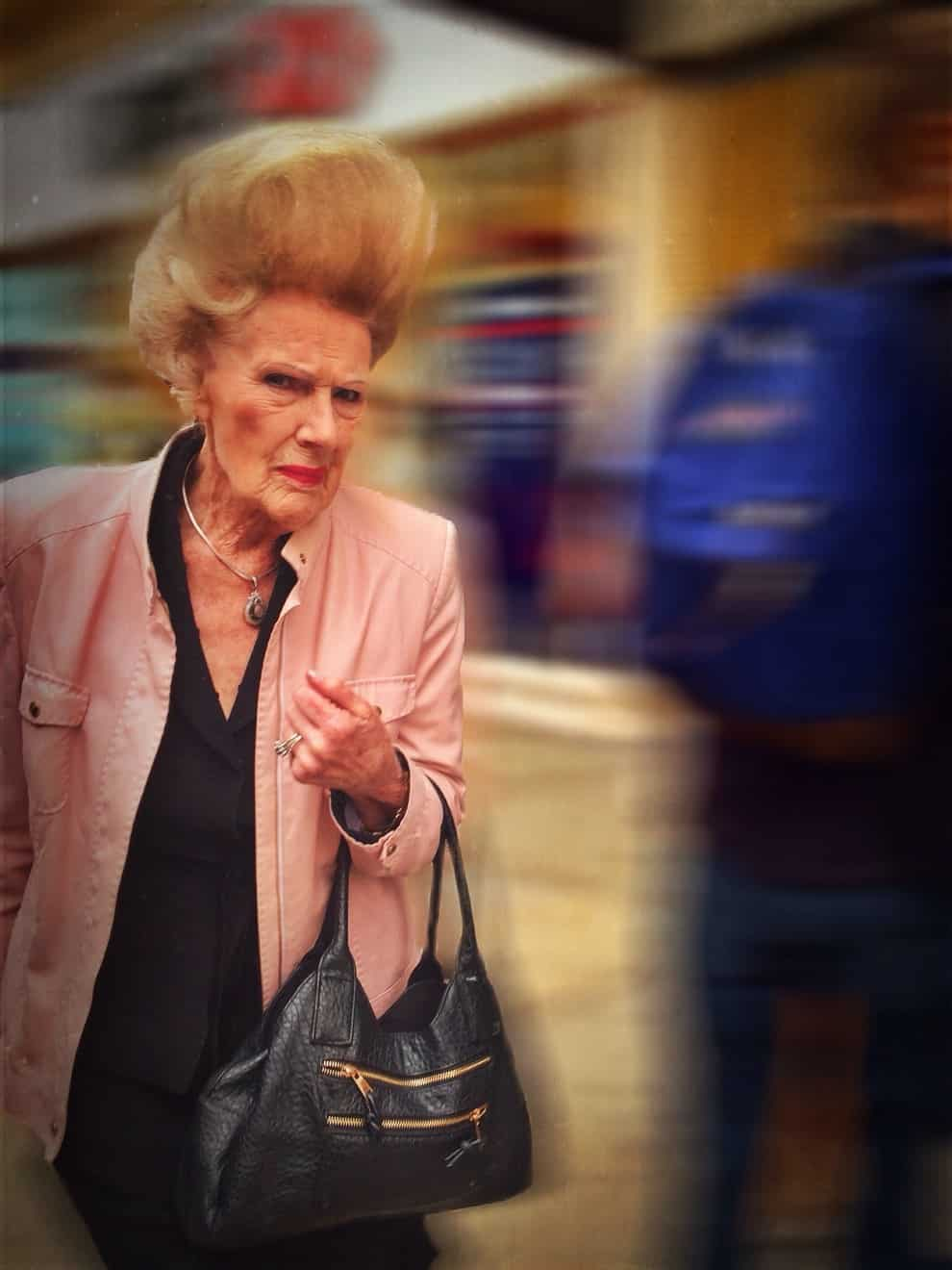 """A real-life Patsy Stone"" from Absolutely Fabulous walks down a street in London."