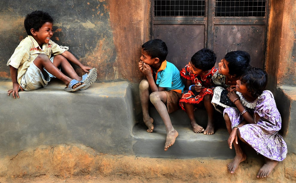 Children giggling together in Medinipur, West Bengal, India.