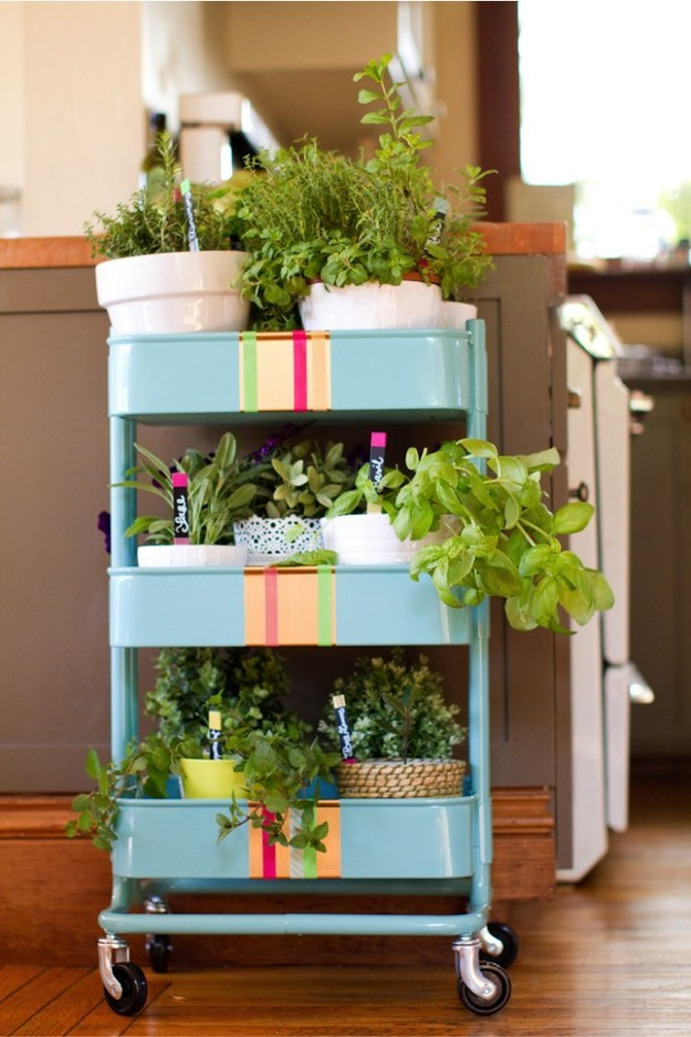 Turn a RÃ¥skog cart into the prettiest portable herb garden ever using some contact paper and washi tape.
