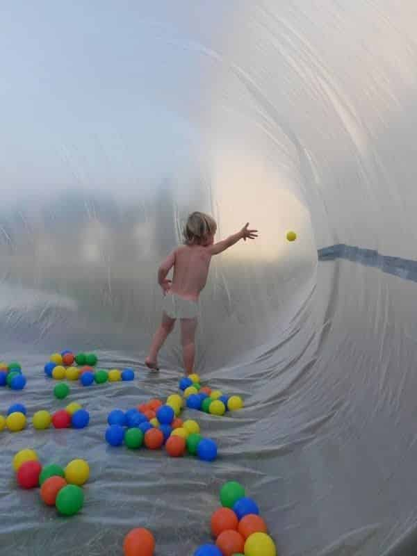 Create a giant bubble with plastic sheeting and a fan.
