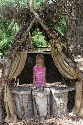 Create a puppet theater out of vines and tree stumps.
