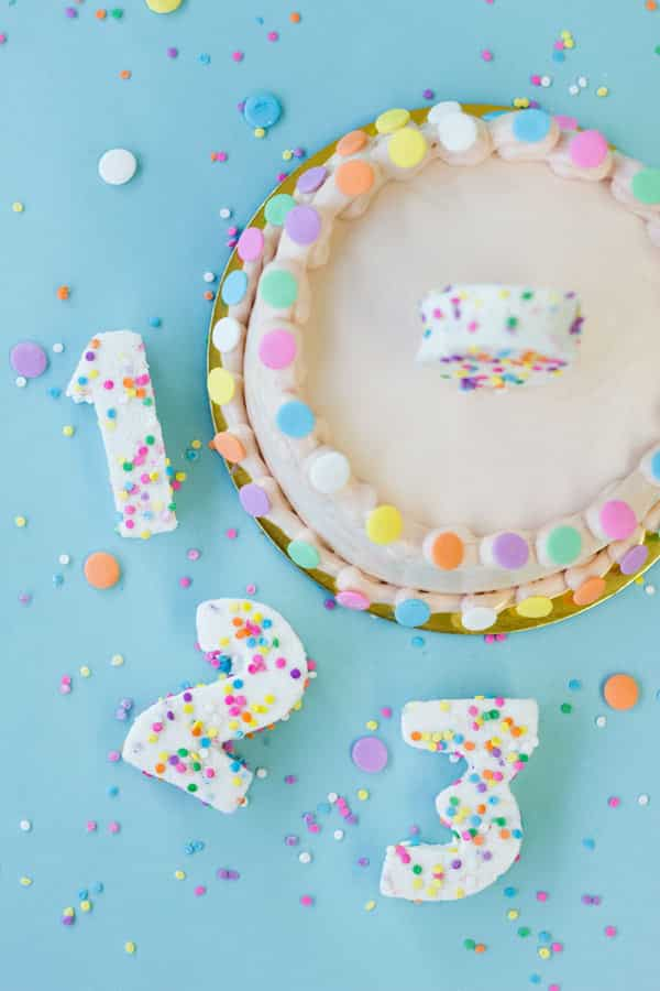 Create number-shaped, confetti-covered marshmallow toppers.