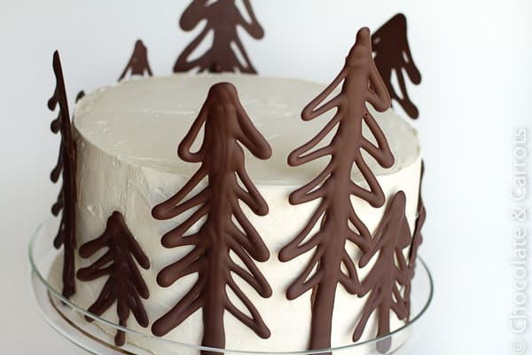 Make your own chocolate cake toppers using melted chocolate.