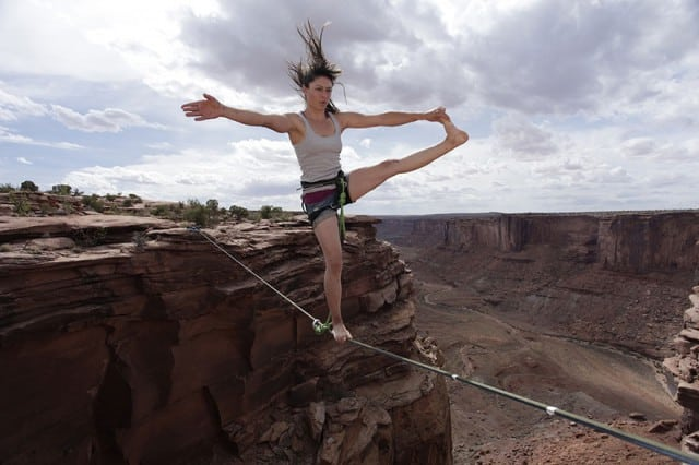 In this death defying photography the young female acrobat looks very confident indeed,
