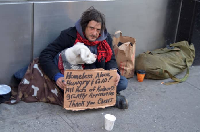 Macintosh HD:Users:brittanyloeffler:Downloads:Upwork:Homeless Veteran:homeless-person-with-sign-dog-shutterstock_96134678-696x461.jpg
