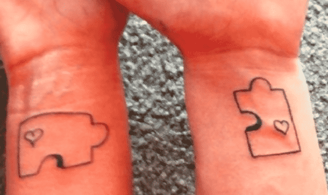 A couple have puzzle pieces tattooed on their wrists, but the pieces are both corner pieces
