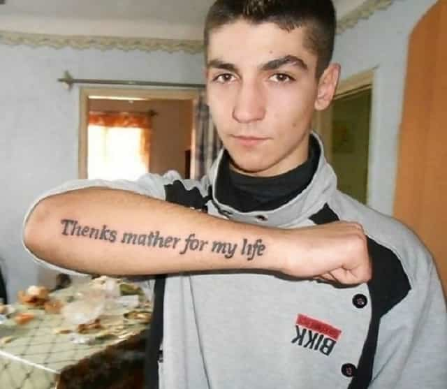 "A tattoo on a young man's arm which says ""Thenks mather for my life."""