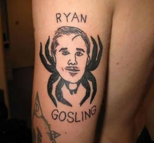 A tattoo on someone's arm which is Ryan Gosling's face on a spider body