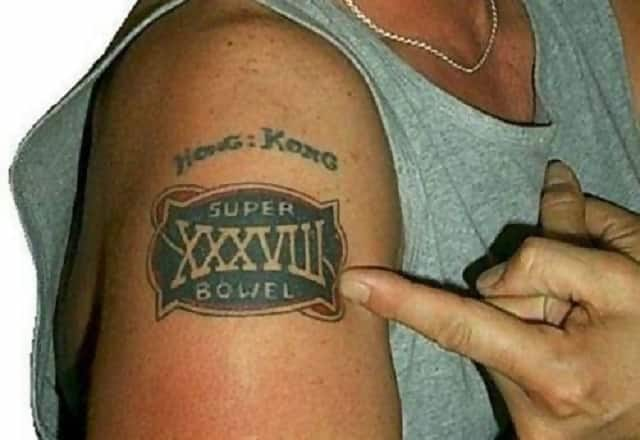 "A tattoo on someone's arm which says ""Super Bowel"" instead of ""Super Bowl"""
