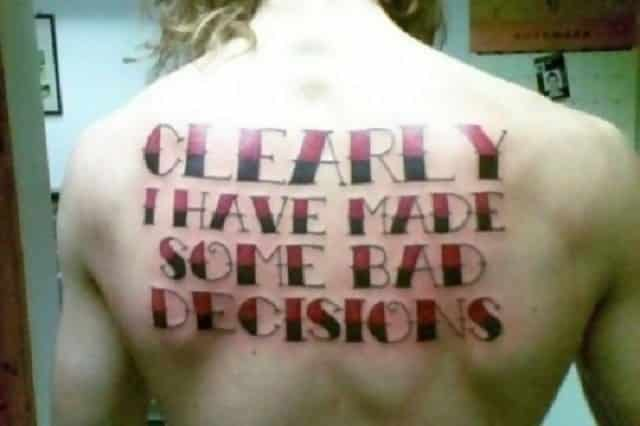 "A tattoo on someone's back which says ""Clearly I have made some bad decisions."""