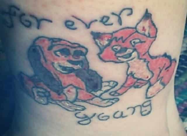 "A tattoo which says ""For ever young"" and shows characters from 'The Fox and the Hound' badly drawn"