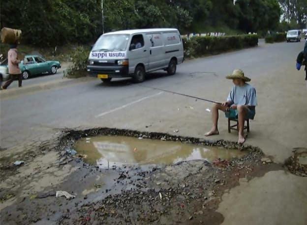 Macintosh HD:Users:rjackson:Desktop:funny-pothole.jpg