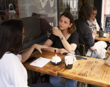 Two Women Having a Meeting in a Cafe