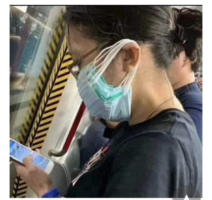 coronavirus meme of passenger on train wearing 8 masks