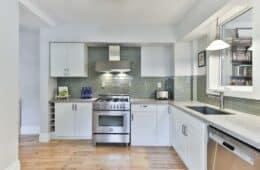 white wooden kitchen cabinet with gray kitchen cabinet